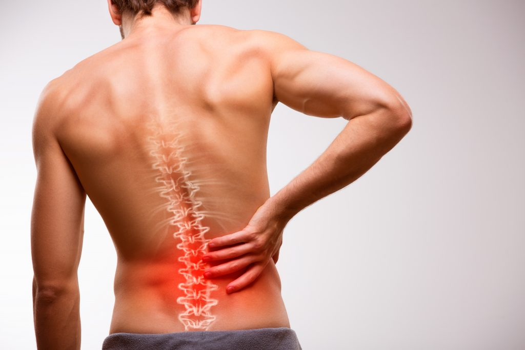 Man suffering back pain, spinal pain